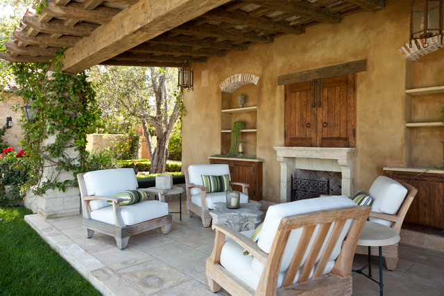 12 mediterranean style stucco house examples for Stucco patio cover designs