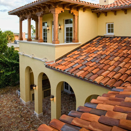 12 mediterranean style stucco house examples for Mediterranean roof styles