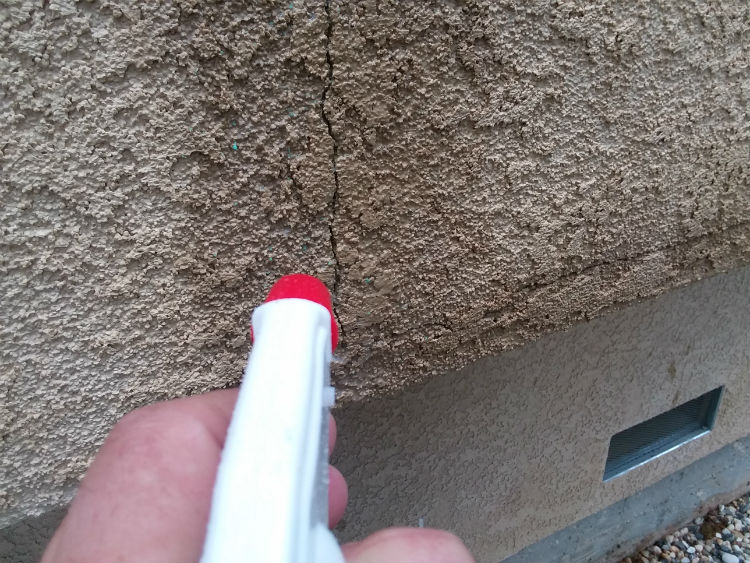 Wet Down Wall Around Crack In Stucco