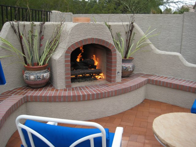 Lace Stucco Textured Fireplace With Brick Accents