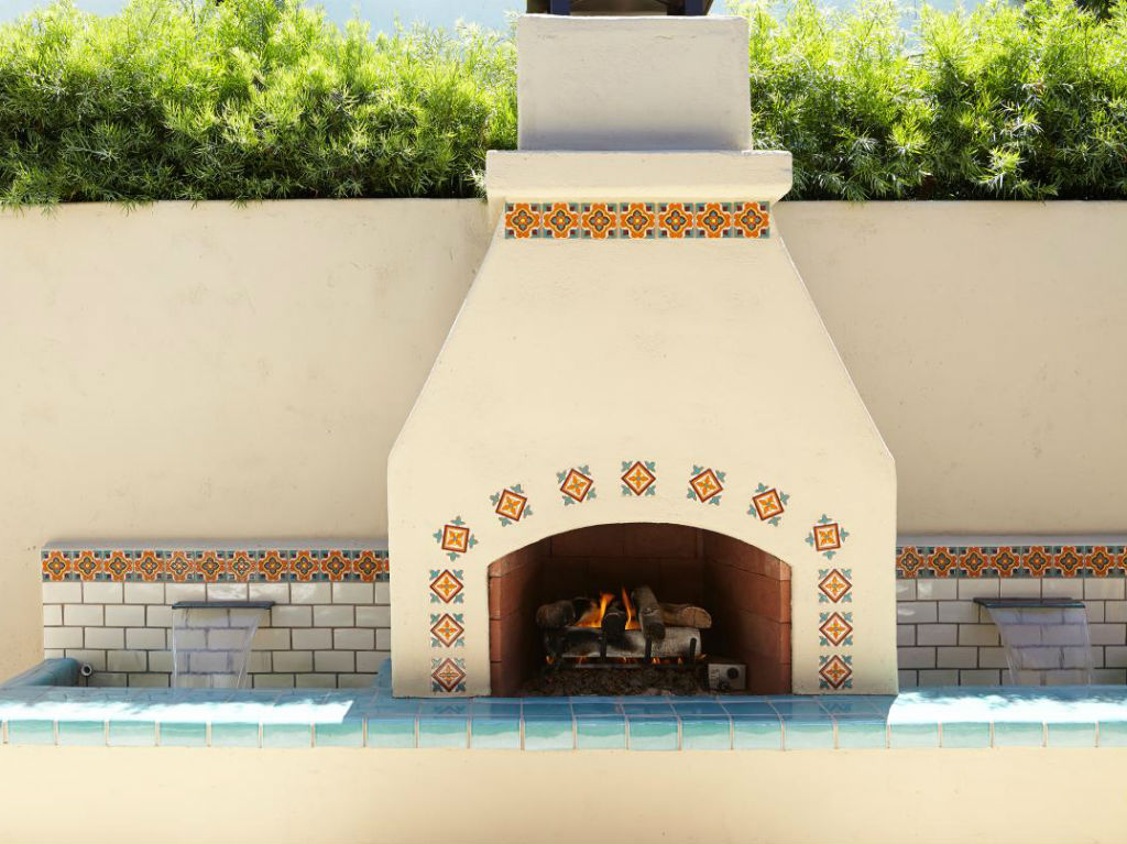 A Clean And Simplistic Look To This Outdoor Stucco Fireplace