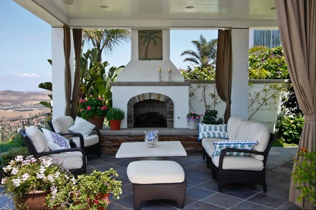 A Clean White Stucco Fireplace On An Outdoor Patio