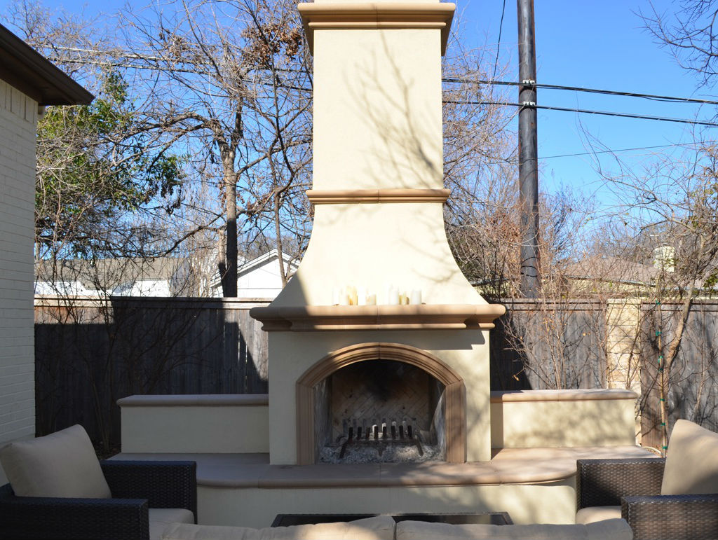 A Tall Outdoor Fireplace Example With Foam Trim