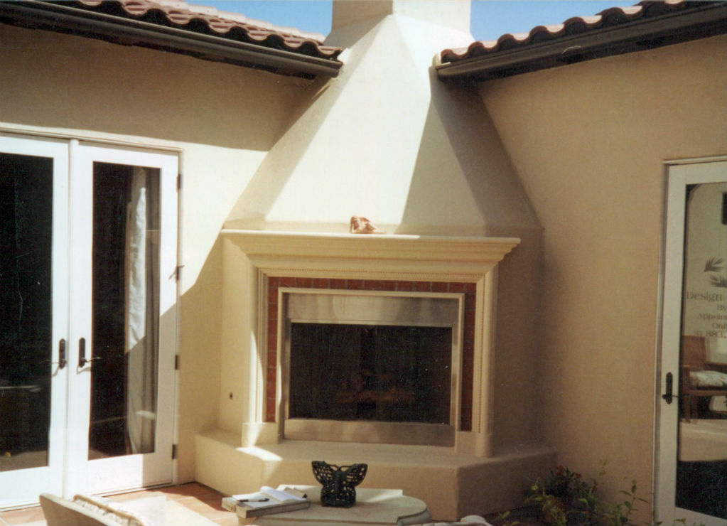 A More Elaborate Corner Fireplace With A Sand Finish Stucco