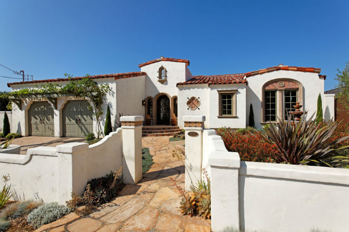 Spanish Style Stucco House With Reddish Tile Roof