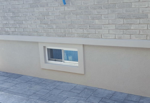 Sand Finish Example On Foundation Wall In An Acrylic Stucco