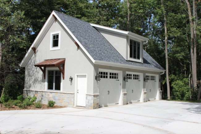 A Beautiful Detached Garage In A Light Gray Color