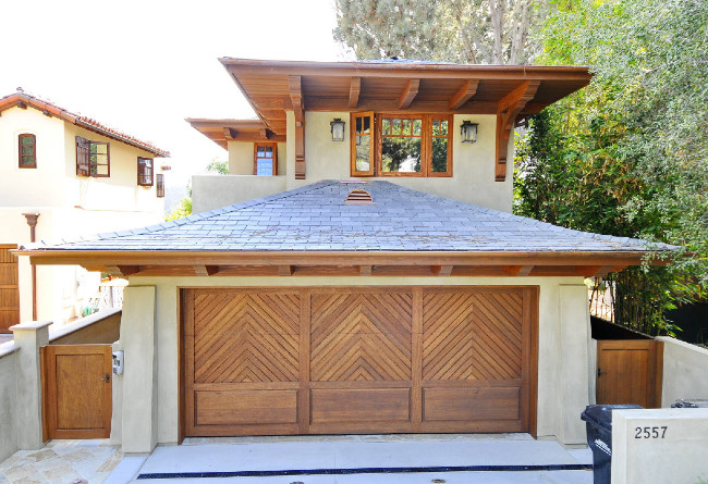 A Lighter Green Stucco With Beautiful Wooden Accents