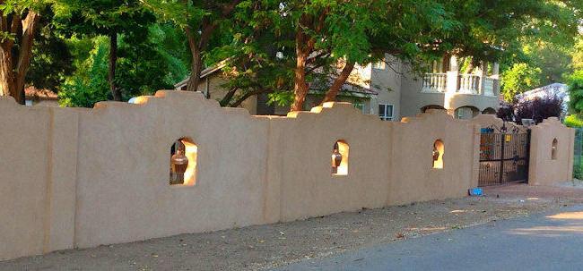 Adobe Style Stucco Fence Idea