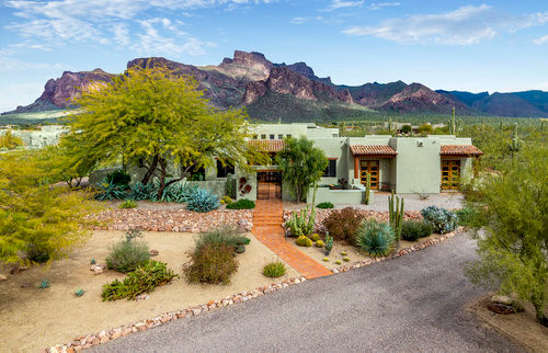 An Adobe Home In A Mint Green Color