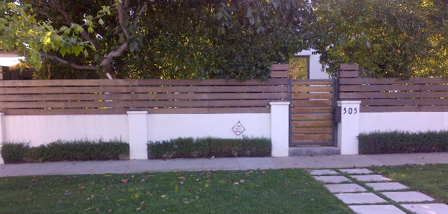 Another Modern Stucco Fence With Wooden Top Slats