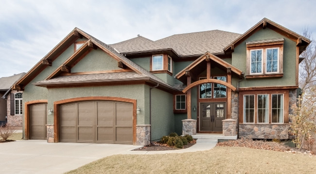 Lots Of Elements With This Green Stucco Residence