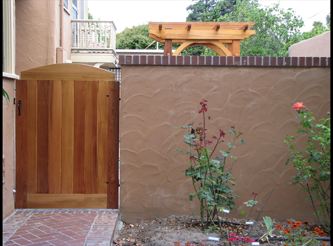Simple Stucco Wall With Brick Top