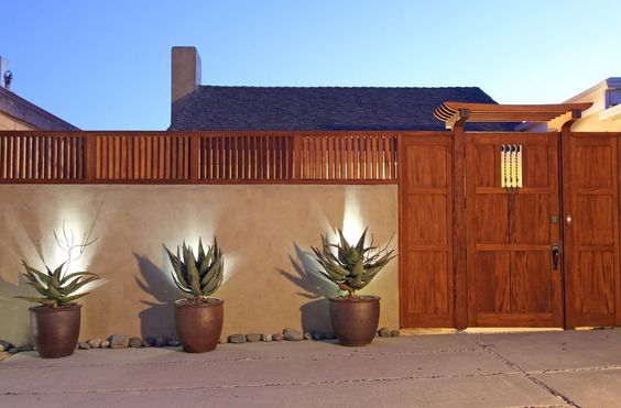 Traditional Stucco Fence With Wood Accents