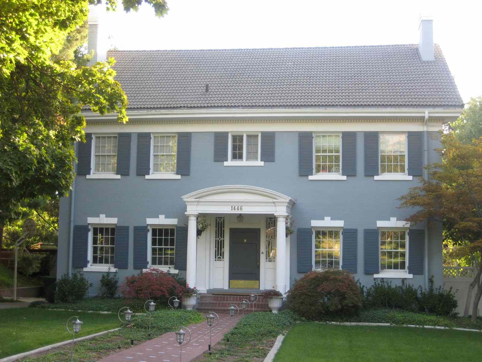 A Big Beautiful Home In A Light Blue Stucco