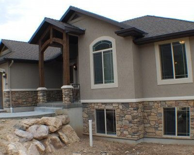 A More Modern Home With Brownish Rocks