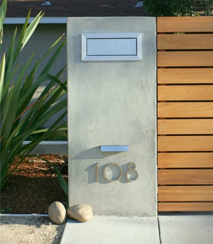 A Simple And Sleek Stucco Mailbox Idea