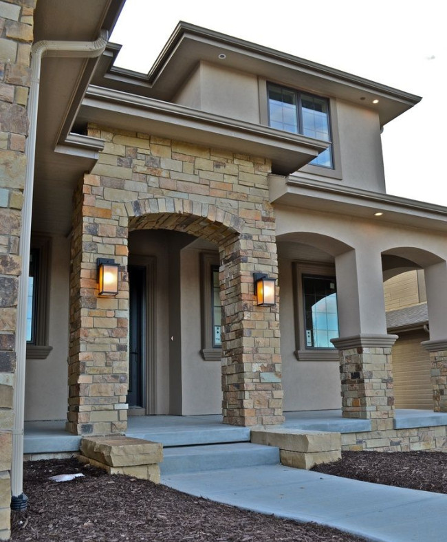 Beige Stone With A Smoother Stucco Finish