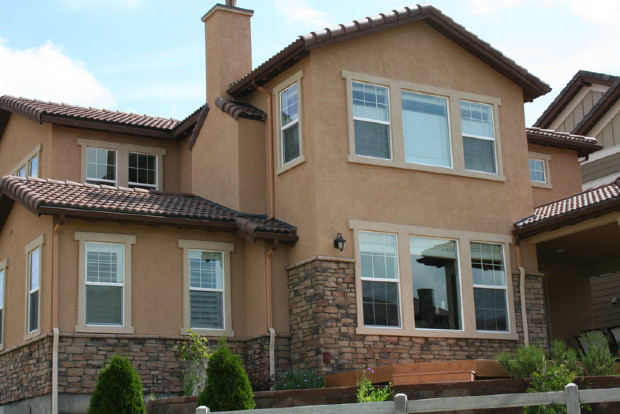 Brown Stone Work With A Tan Stucco Color