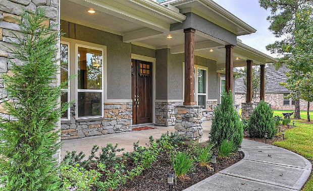Gray And Tan Rock Work With A Darker Gray Stucco