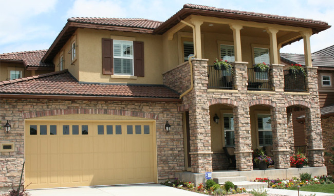 Tan Stones With A Yellow Stucco Finish