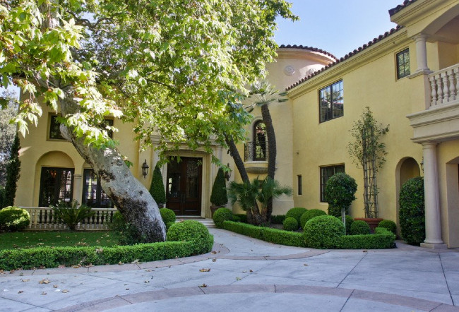 A Larger Home In A Light Yellow Stucco Color