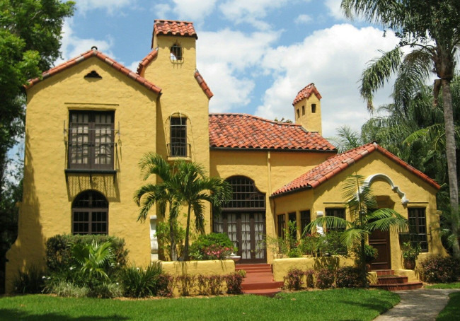 A Revival Homewith A Textured Yellow Stucco