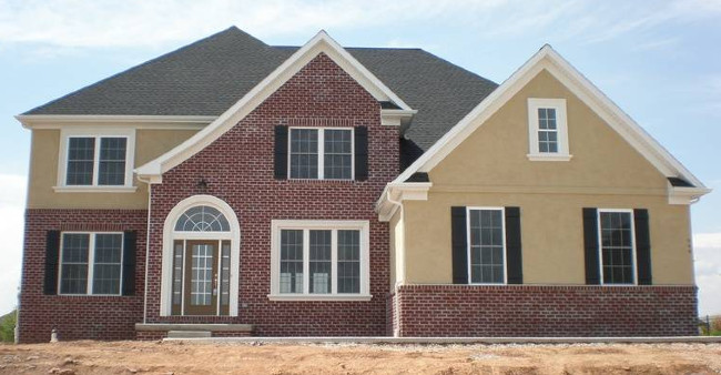 Brick And Stucco House With White Trim