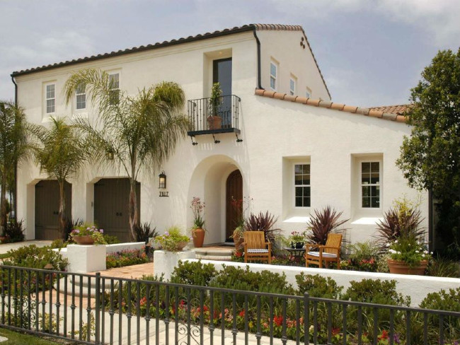 Cream Colored Stucco Walls With A Tile Roof