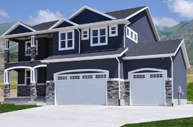 Deep Dark Blue House With Gray Rock And Bright Trim
