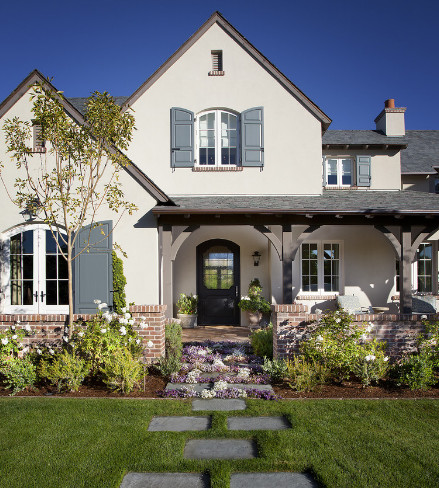 English Style Home With White Stucco And Red Bricks