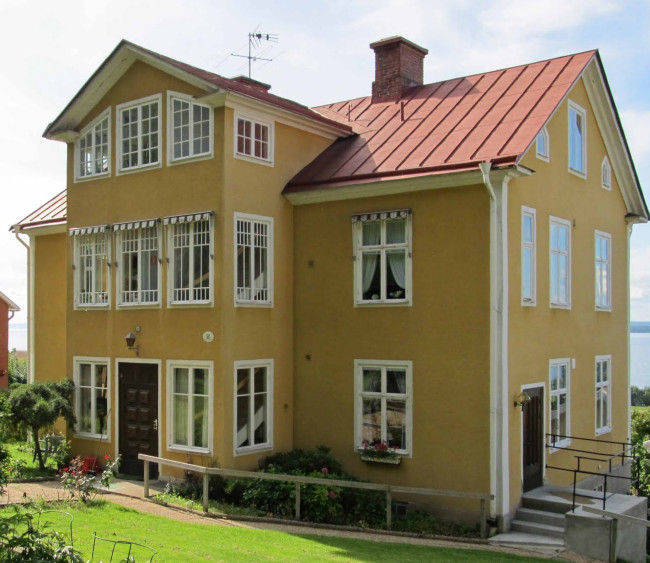 Large, Yellow House With Red Metal Roof