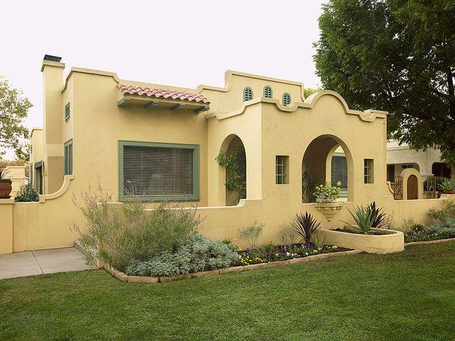 Light Yellow Spanish Bungalow With Sage Green Trim
