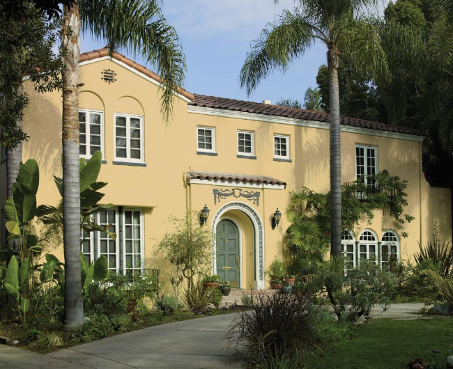 Lighter Yellow Stucco Walls And Beautiful Landscaping