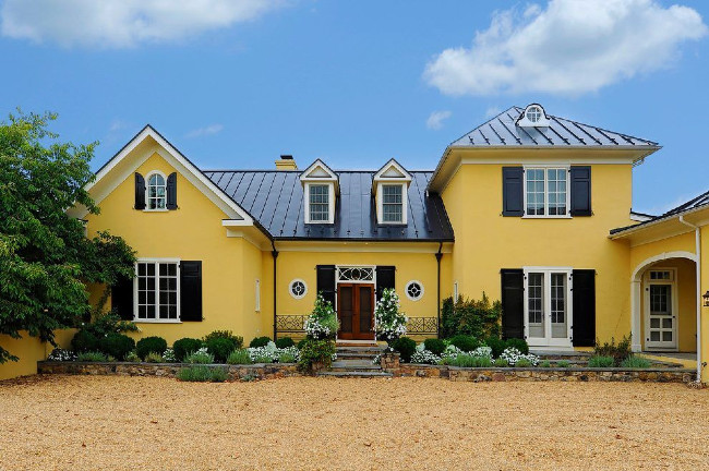 Rich Yellow Color With A Dark Metal Roof